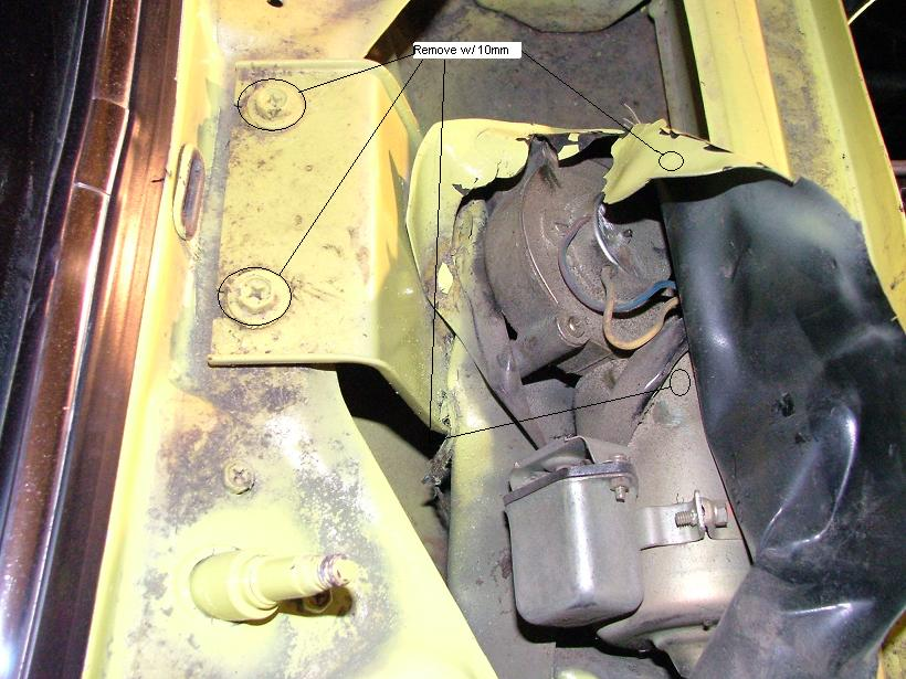 now pull the bracket back to expose the 12mm nut holding the wiper motor to  the mechanism  remove this nut with a wrench